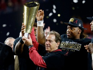 GLENDALE, AZ - JANUARY 11: Head coach Nick Saban of the Alabama Crimson Tide celebrates by hoisting the College Football Playoff National Championship Trophy after defeating the Clemson Tigers in the 2016 College Football Playoff National Championship Game at University of Phoenix Stadium on January 11, 2016 in Glendale, Arizona. The Crimson Tide defeated the Tigers with a score of 45 to 40. (Photo by Sean M. Haffey/Getty Images)