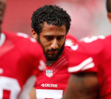 colin-kaepernick-takes-a-stand-by-sitting-during-national-anthem